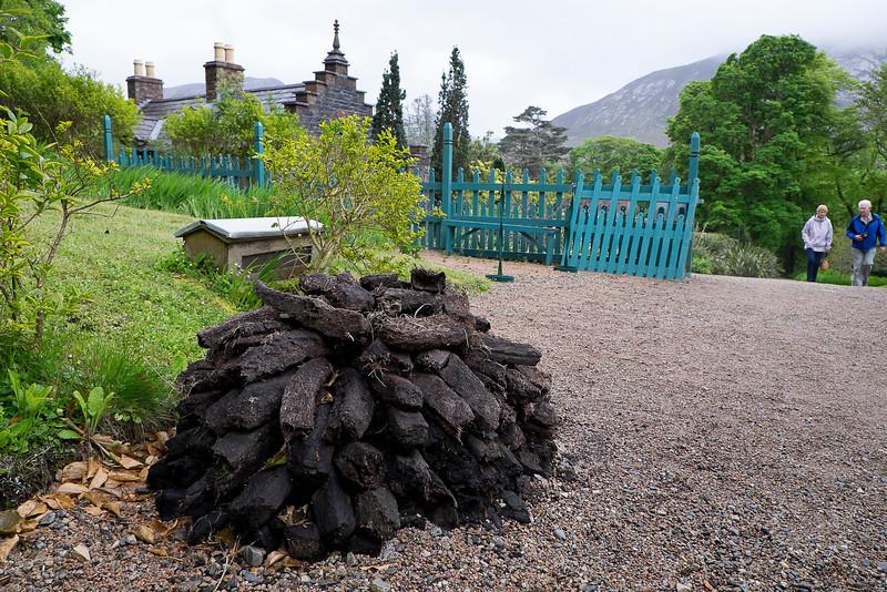 Turf ready for burning stacked outside the gardener's house.