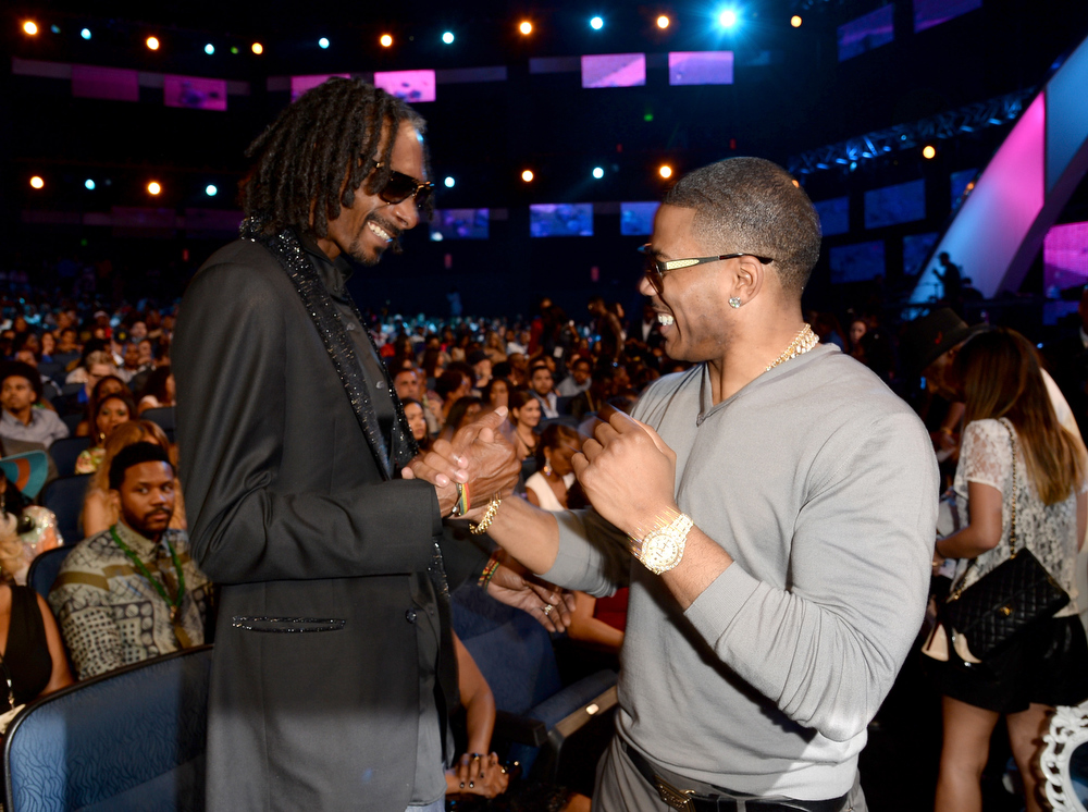 Description of . Recording Artists Snoop Dogg and Nelly in the audience during the 2013 BET Awards at Nokia Theatre L.A. Live on June 30, 2013 in Los Angeles, California.  (Photo by Jason Merritt/Getty Images for BET)