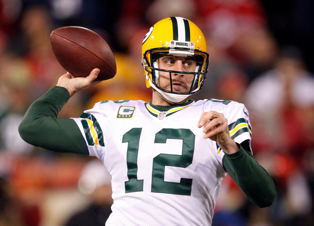 Description of . Green Bay Packers quarterback Aaron Rodgers (12) passes against the San Francisco 49ers during the first quarter of an NFC divisional playoff NFL football game in San Francisco, Saturday, Jan. 12, 2013. (AP Photo/Tony Avelar)
