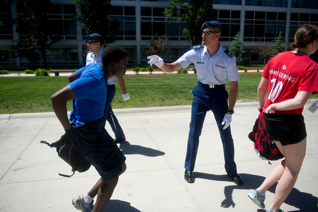 . COLORADO SPRINGS, CO. - JUNE 27: Basic Cadet Trainees tuck in their shirts while rushing from the bus to get into formation during inprocessing of the class of 2017 at the Air Force Academy on June 27, 2013. (Photo By Grant Hindsley/The Denver Post)