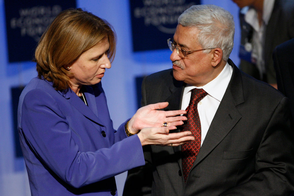 . In this Jan. 25, 2007 file photo, Israeli Foreign Minister Tzipi Livni, left, and President of the Palestinian Authority Mahmoud Abbas talk after a plenary session on the Middle East during the World Economic Forum in Davos, Switzerland. The Palestinian president will invite Israeli politicians to the West Bank to try to make sure peacemaking is on the new government\'s agenda, a senior official said Thursday Jan. 24, 2013,  as a top Israeli hard-liner proposed sidelining the polarizing issue.(AP Photo/Keystone/Alessandro della Valle, File)