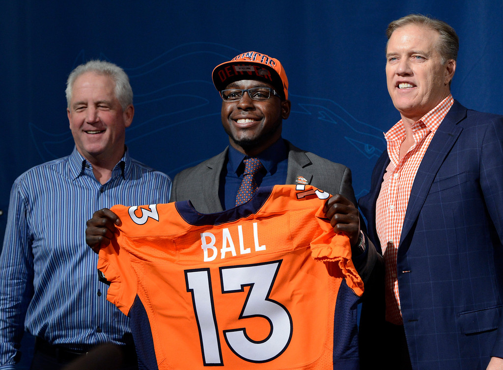 . ENGLEWOOD, CO. - APRIL 27: Denver Broncos Head Coach John Fox, left and Executive Vice President of Football Operations John Elway, right, introduce RB Montee Ball during a press conferences at the team�s training facility in Englewood, CO April 27, 2013. (Photo By Craig F. Walker/The Denver Post)