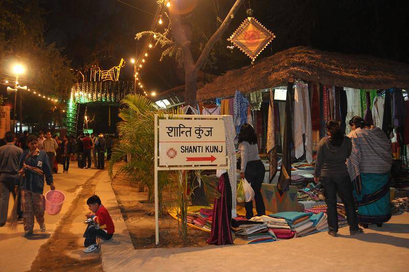 Shop and stalls at Shanti Kunj, Surajkund Mela. Suraj Kund Mela 2009 held in Haryana (outskirts of Delhi), North India. The Suraj Kund Mela is an annual fair held near Delhi. Folk dances, handicrafts and a lot of fun.