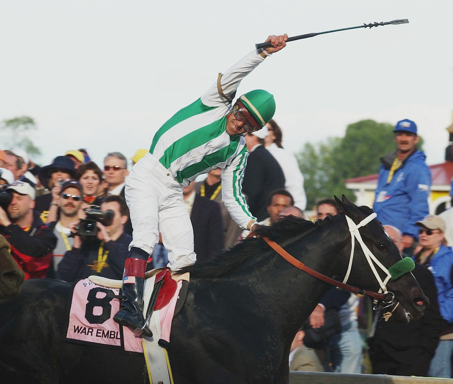 . Jockey Victor Espinoza reacts as he rides War Emblem to victory in the 127th Preakness, at Pimlico Race Course, Saturday, May 18, 2002, in Baltimore, to capture the second jewel of horse racing\'s Triple Crown. War Emblem didn\'t manage all three victories, however, finishing eighth to Sarava at Belmont. (AP Photo/Bill Waugh)