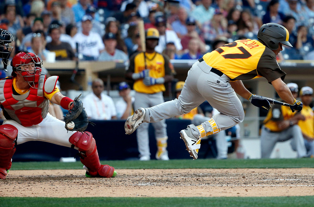 . World Team\'s Francisco Mejia, of the Cleveland Indians, leaps out of the way as U.S. Team catcher Carson Kelly, of the St. Louis Cardinals, catches the ball during the eighth inning of the All-Star Futures baseball game, Sunday, July 10, 2016, in San Diego. (AP Photo/Lenny Ignelzi)
