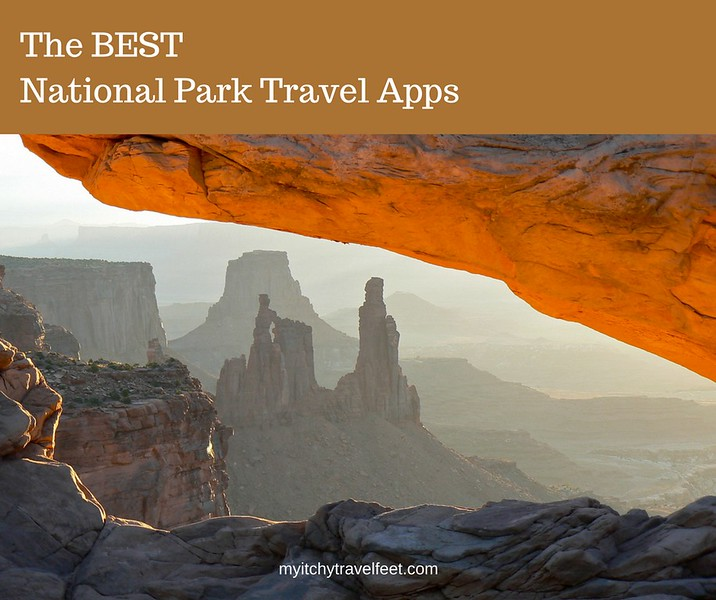 The BEST National Park Apps. Photo: Sunrise on Mesa Arch with stone formations in the distance.