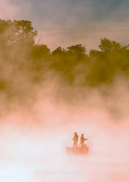 Two fisherman fish on a foggy Whitmore Lake early Sunday morning.  (MARK BIALEK/Special to the Detroit News)