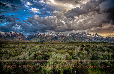 Clouds thunder over the Tetons at sunset