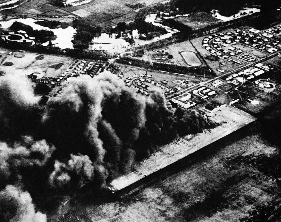 . Flaming oil throws a billow of smoke skyward in the Japanese attack on Hickam Field, Pearl Harbor, U.S. Air base near Honolulu, Dec. 7, 1941. (AP Photo)