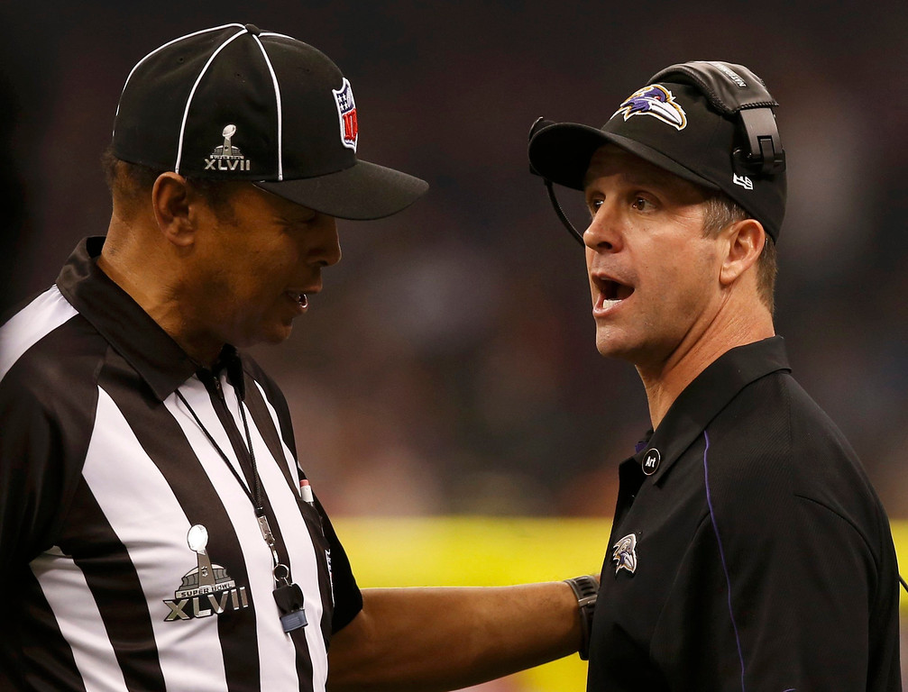 . Baltimore Ravens head coach John Harbaugh talks to referee Jerome Boger as the lights return in the third quarter following a power failure in the NFL Super Bowl XLVII foorball game against the San Francisco 49ers in New Orleans, Louisiana, February 3, 2013 REUTERS/Mike Segar