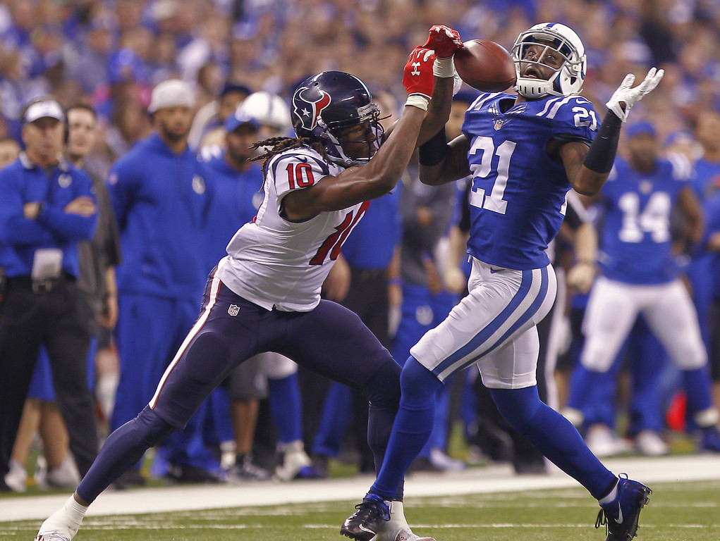 . INDIANAPOLIS, IN - DECEMBER  14: DeAndre Hopkins #10 of the Houston Texans  and Vontae Davis #21 of the Indianapolis Colts battle for a pass at Lucas Oil Stadium on December 14, 2014 in Indianapolis, Indiana. (Photo by Michael Hickey/Getty Images)