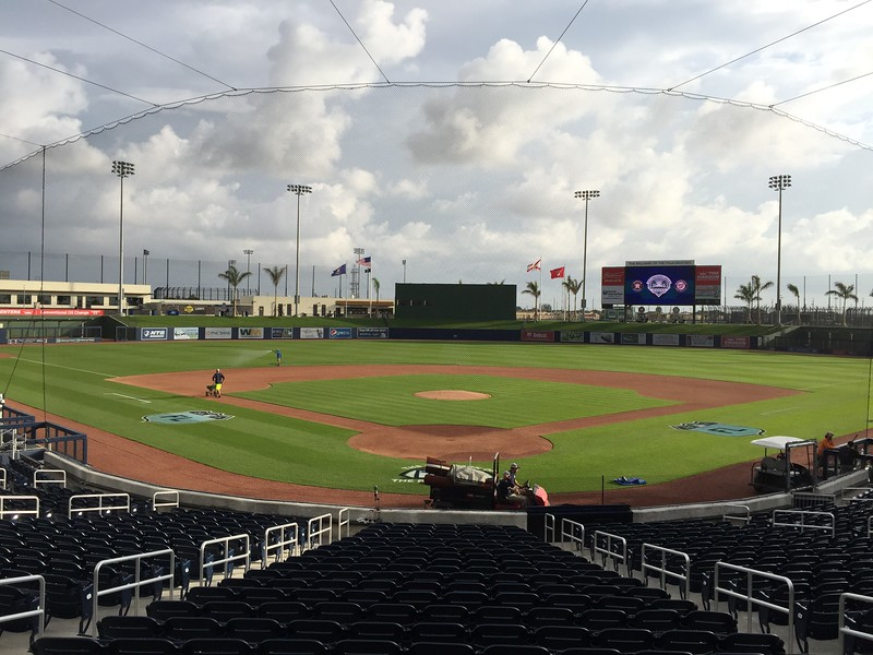 Grounds crew work on the field at The Ballpark of the Palm Beaches on opening day of Spring Training. (Joseph Forzano / The Palm Beach Post)