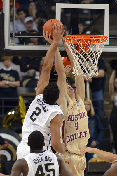Devin Thomas blocks shot by Odio.jpg