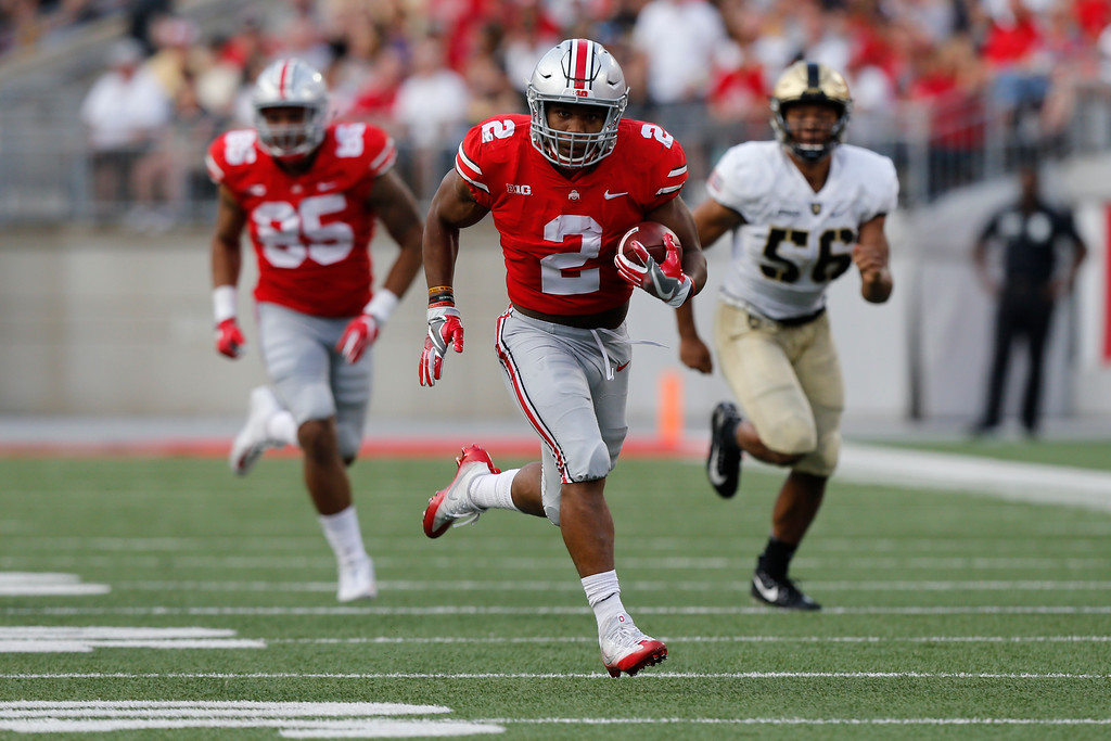 . FILE - In this Sept. 16, 2017, file photo, Ohio State running back J.K. Dobbins carries against Army during an NCAA college football game in Columbus, Ohio. With last year�s 1,000-yard back, Mike Weber, still hampered by a hamstring pull, Dobbins again will get most of the work this week against UNLV. (AP Photo/Jay LaPrete, File)