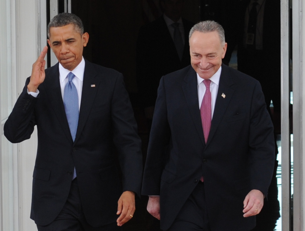 Description of . US President Barack Obama and US Democratic Senator from New York Chuck Schumer, the chairman of the Joint Congressional Committee on Inaugural Ceremonies, leave the White House on January 21, 2013 for the US Capitol in Washington, DC, for the ceremonial swearing in of the president and vice president to a second term in office.   ROD LAMKEY JR./AFP/Getty Images