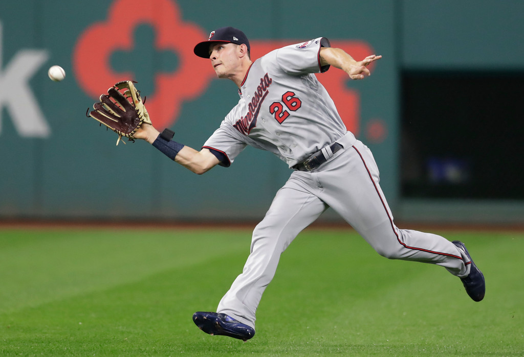 . Minnesota Twins\' Max Kepler catches a ball hit by Cleveland Indians\' Rajai Davis during the second inning of a baseball game, Tuesday, Aug. 7, 2018, in Cleveland. (AP Photo/Tony Dejak)