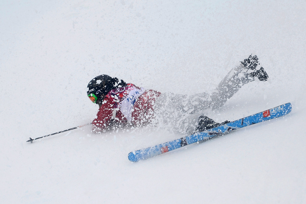 . Canada\'s Yuki Tsubota crashes on her last run in the women\'s freestyle skiing slopestyle final at the Rosa Khutor Extreme Park, at the 2014 Winter Olympics, Tuesday, Feb. 11, 2014, in Krasnaya Polyana, Russia.  (AP Photo/Andy Wong)