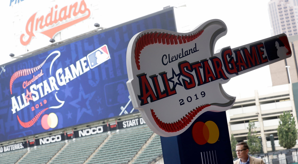 . The new logo for the 2019 All-Star Game is displayed, Tuesday, Aug. 7, 2018, in Cleveland. Indians took the rock \'n\' roll route with a logo for the 2019 All-Star Game that won\'t offend anyone. The Indians are hosting the event for the sixth time, and next year\'s game coincides with the 25th anniversary of Progressive Field. (AP Photo/Tony Dejak)