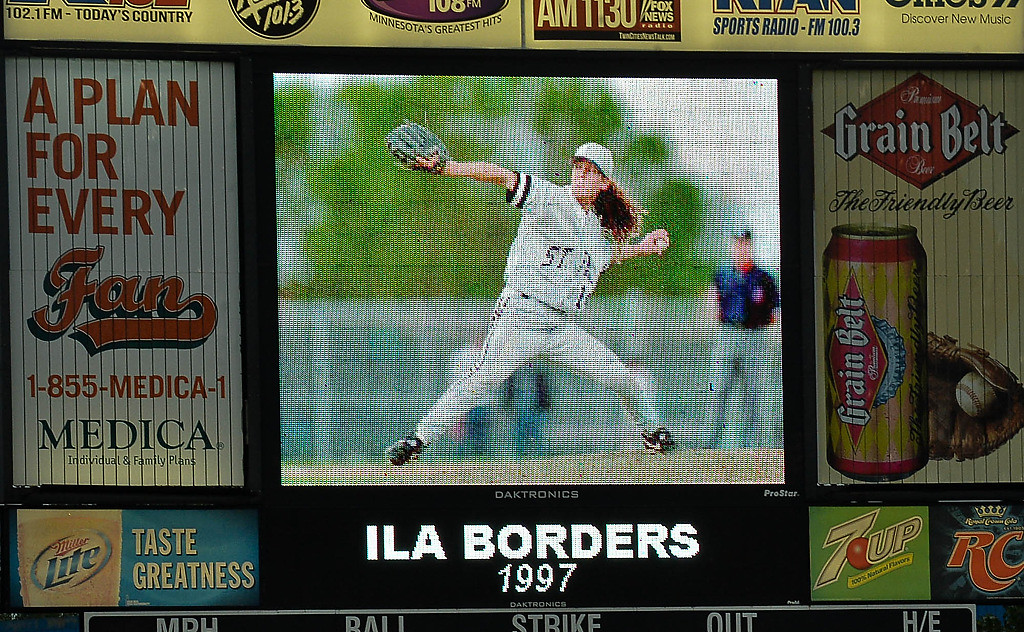 . Former Saints pitcher Ila Borders, who was unable to make it to the game, was honored on the scoreboard. (Pioneer Press: Ben Garvin)