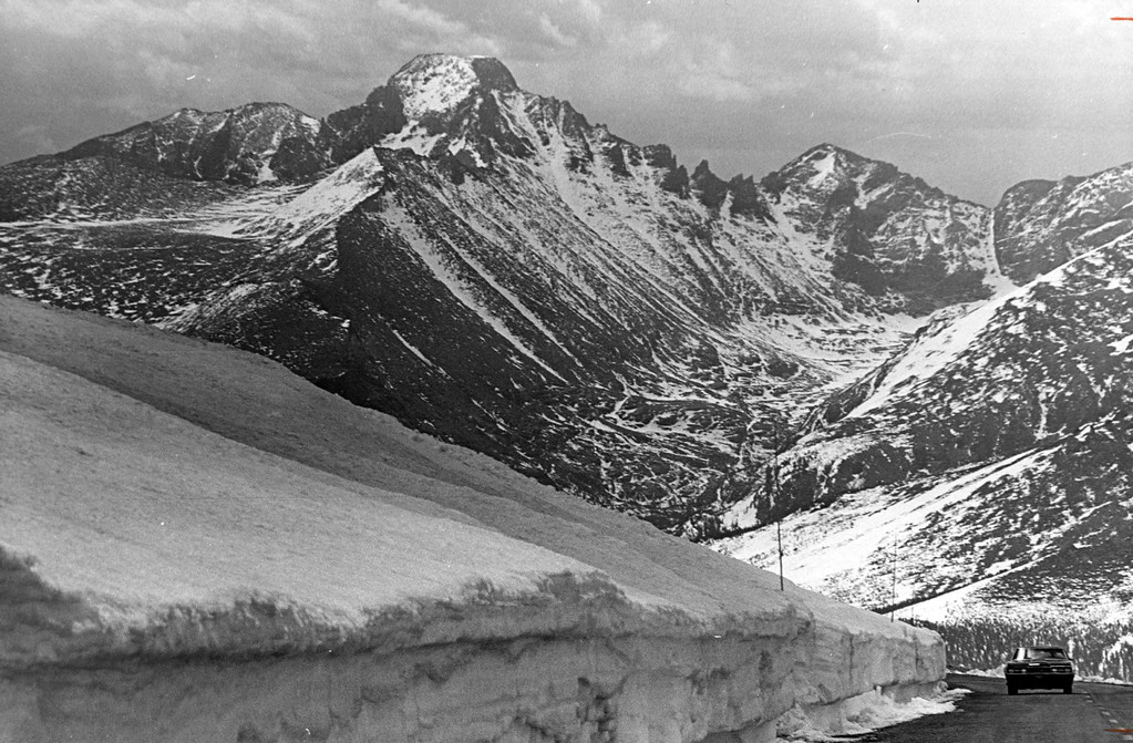. Magnificent Scenery awaits the motorist who travels trail ridge road in Rocky Mountain National Park in June, 1968. The Majestic peak at left center is 14,256-foot longs peak. (Denver Post Library photo archive)