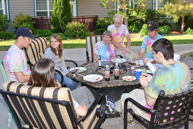 Daphne, Torid, Heather, Judy, Bill, Garrett and Ben sitting around the fire pit after eating barbeque.
