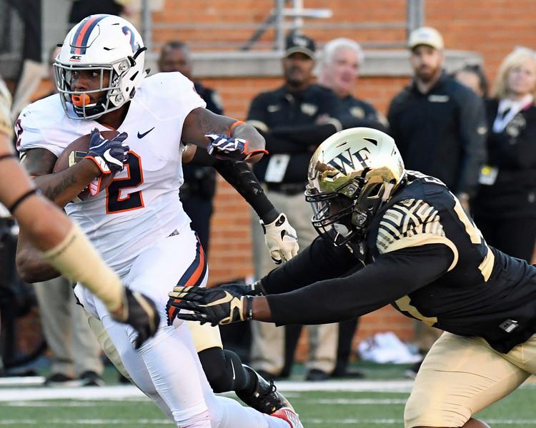 Duke Ejiofor chases A Reid.jpg