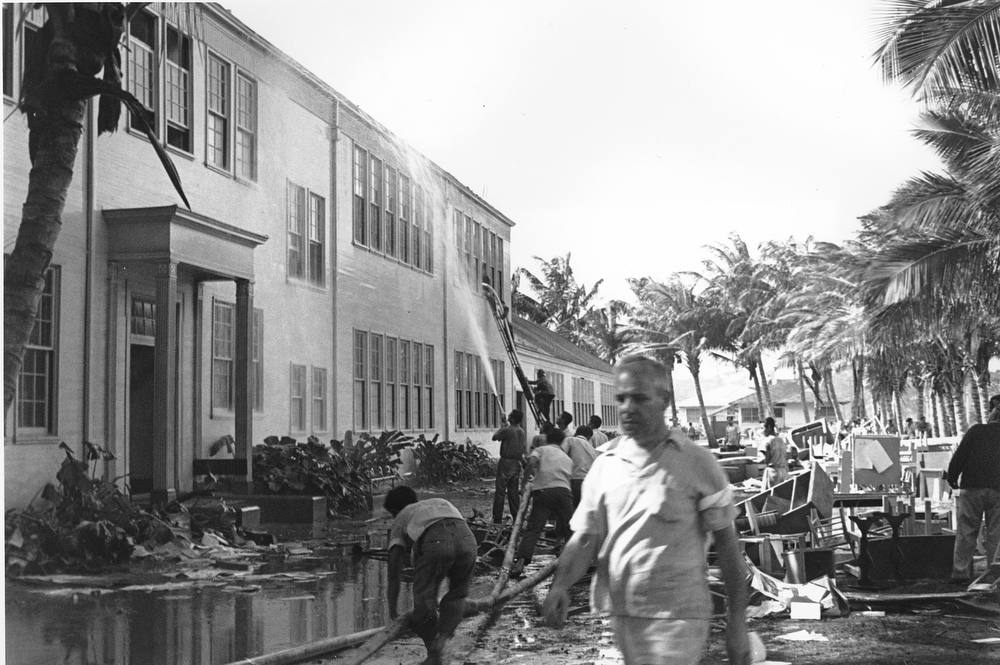 Description of . Rescue workers help evacuate the Lunalilo High School in Honolulu after the roof of the main building was hit by a bomb during the Japanese attack at Pearl Harbor, Hawaii in this Dec. 7, 1941 file photo.  (AP Photo/File)