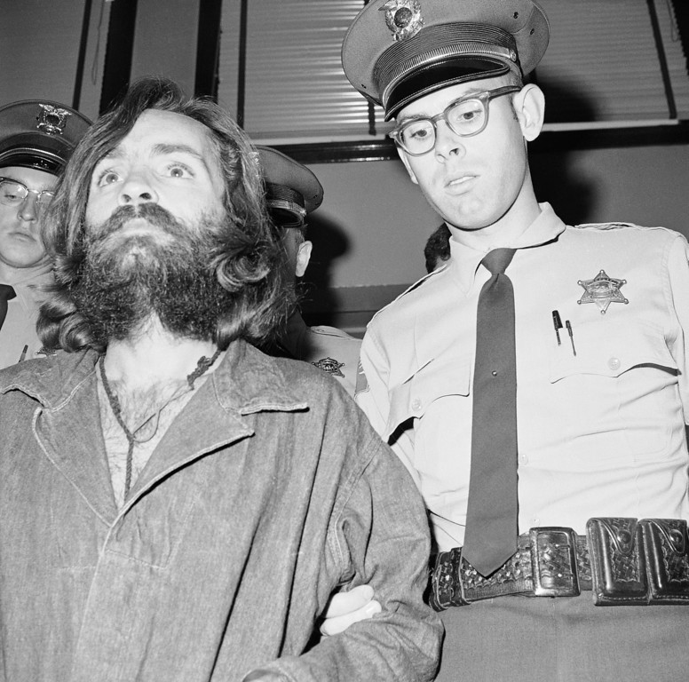 . This is Charles Manson, leader of a cult of hippies, shown Dec. 4, 1969, some of whose members have been linked to the murder of actress Sharon Tate and seven others in the Los Angeles area. Manson is pictured en route to court in Independence, Calif., for a preliminary hearing on charges of possessing stolen property. (AP Photo/Harold Filan)