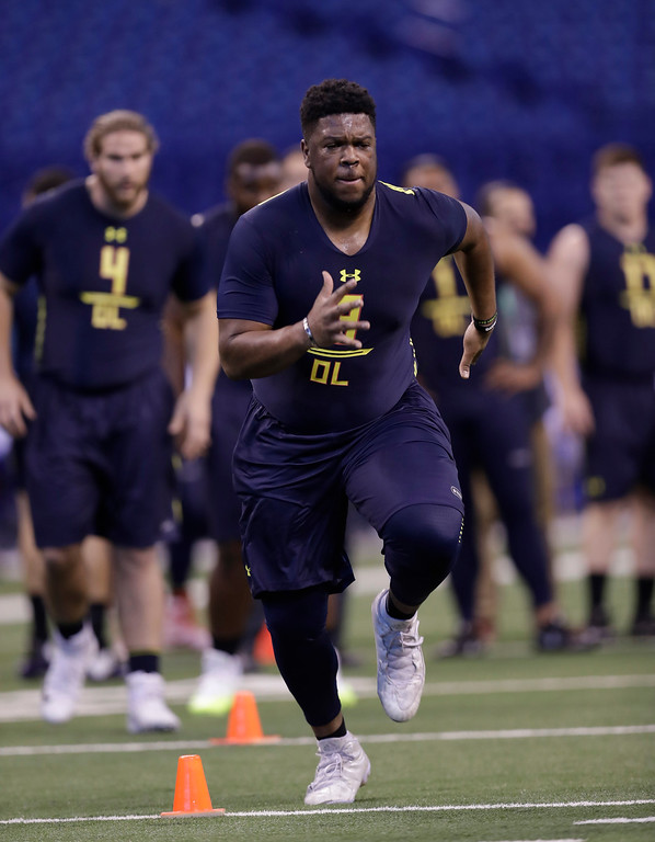 . Miami of Ohio offensive lineman Collin Buchanan runs a drill at the NFL football scouting combine Friday, March 3, 2017, in Indianapolis. (AP Photo/David J. Phillip)