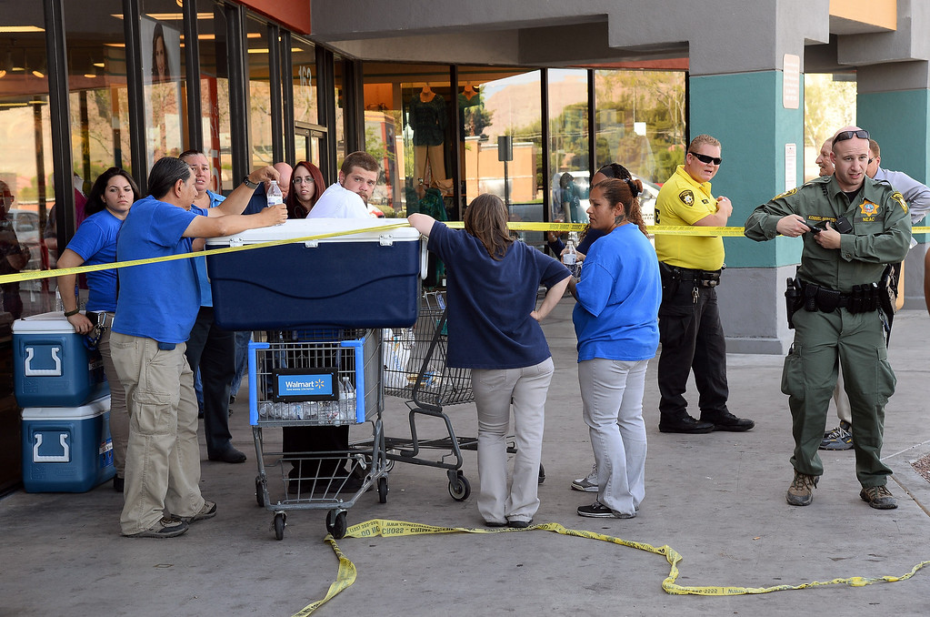 . Las Vegas  Metropolitan Police Department officers stand near Wal-Mart employees near their store on June 8, 2014 in Las Vegas, Nevada.  (Photo by Ethan Miller/Getty Images)