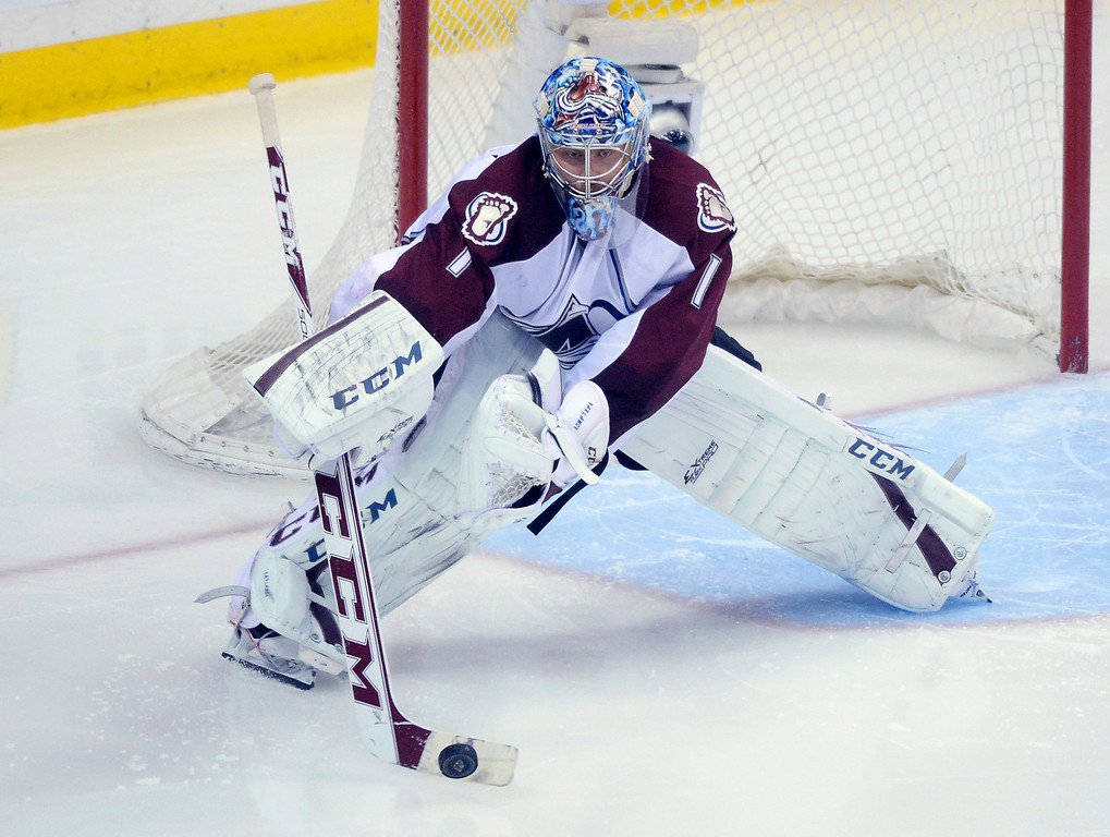 . Colorado goalie Semyon Varlamov cleared the puck away from the net in the third period. The Minnesota Wild hosted the Colorado Avalanche at the Xcel Energy Center in St. Paul Monday night, April 21, 2014. (Photo by Karl Gehring/The Denver Post)