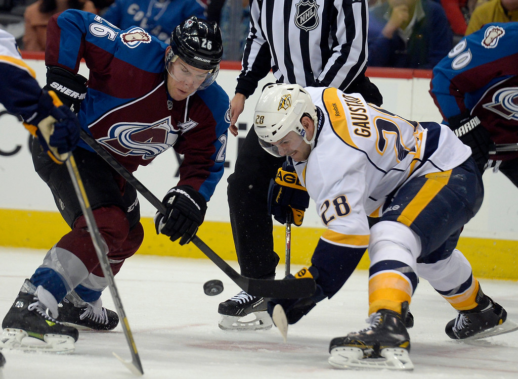 . Colorado Avalanche center Paul Stastny (26) and Nashville Predators center Paul Gaustad (28) battle for a face off late in the third period November 6, 2013 at Pepsi Center. The Nashville Predators defeated the Colorado Avalanche 6-4. (Photo by John Leyba/The Denver Post)