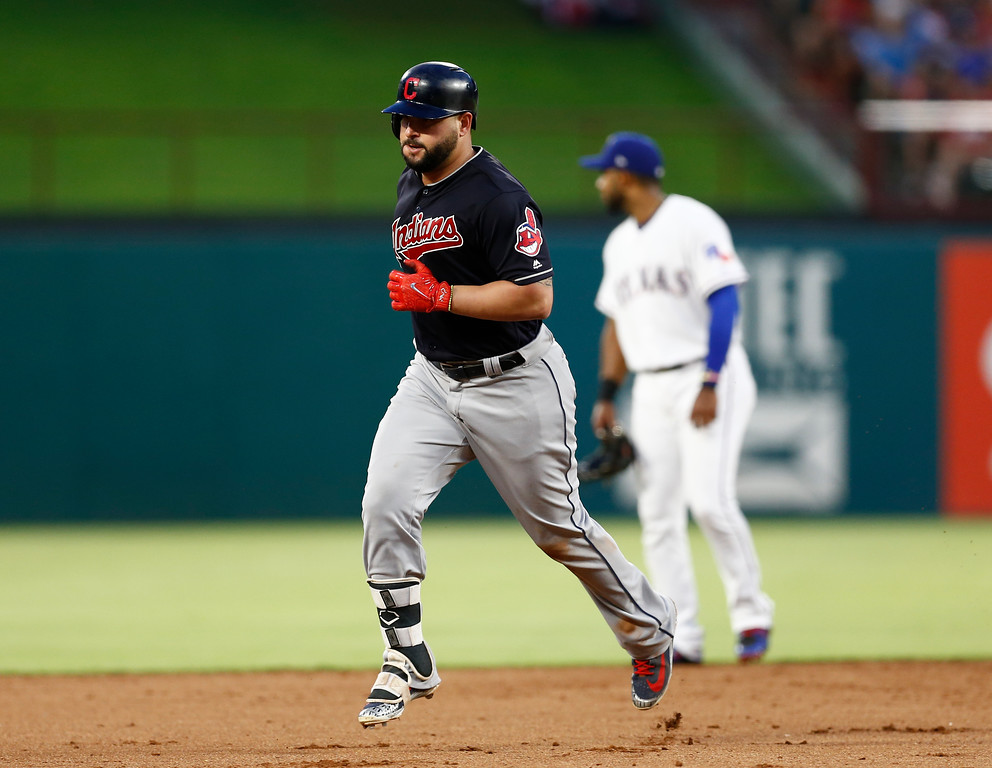 . Cleveland Indians\' Yonder Alonso, left, circles the bases past Texas Rangers shortstop Elvis Andrus, right, on his two-run home run during the fifth inning of a baseball game, Saturday, July 21, 2018, in Arlington, Texas. (AP Photo/Jim Cowsert)
