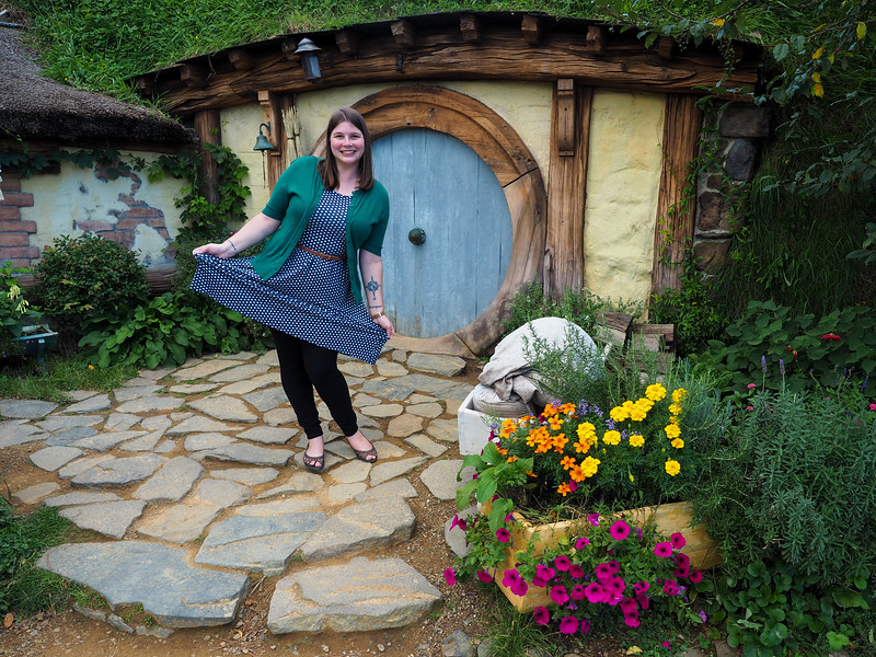 Amanda in front of a hobbit hole