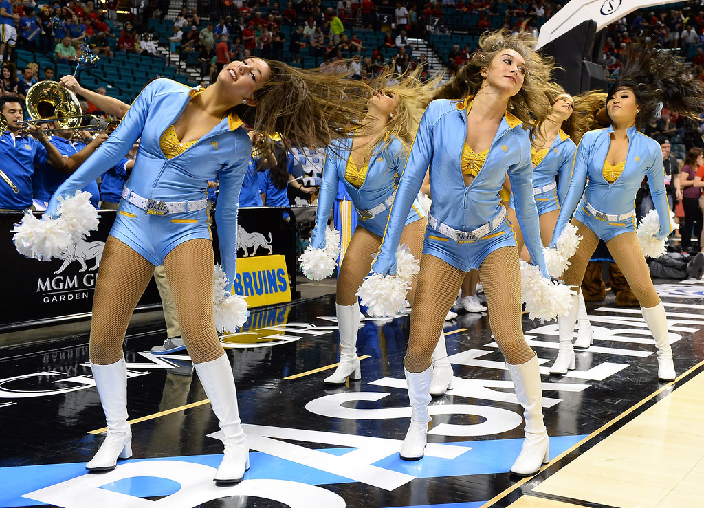 . UCLA Bruins cheerleaders perform before the championship game of the Pac-12 Basketball Tournament against the Arizona Wildcats at the MGM Grand Garden Arena on March 15, 2014 in Las Vegas, Nevada. UCLA won 75-71.  (Photo by Ethan Miller/Getty Images)
