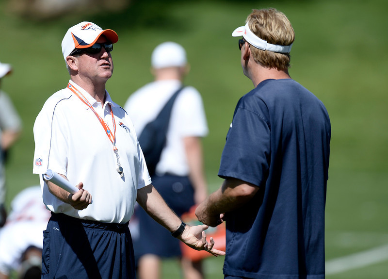 . Head coach John Fox talks with defensive coordinator Jack Del Rio of the Denver Broncos during OTAs June 3, 2013 at Dove Valley. (Photo By John Leyba/The Denver Post)
