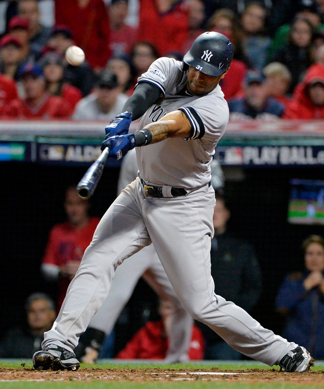 . New York Yankees\' Aaron Hicks hits a single in the ninth inning against the Cleveland Indians in Game 5 of a baseball American League Division Series, Wednesday, Oct. 11, 2017, in Cleveland. Hicks advanced to second base on an error by Indians\' Austin Jackson. (AP Photo/Phil Long)