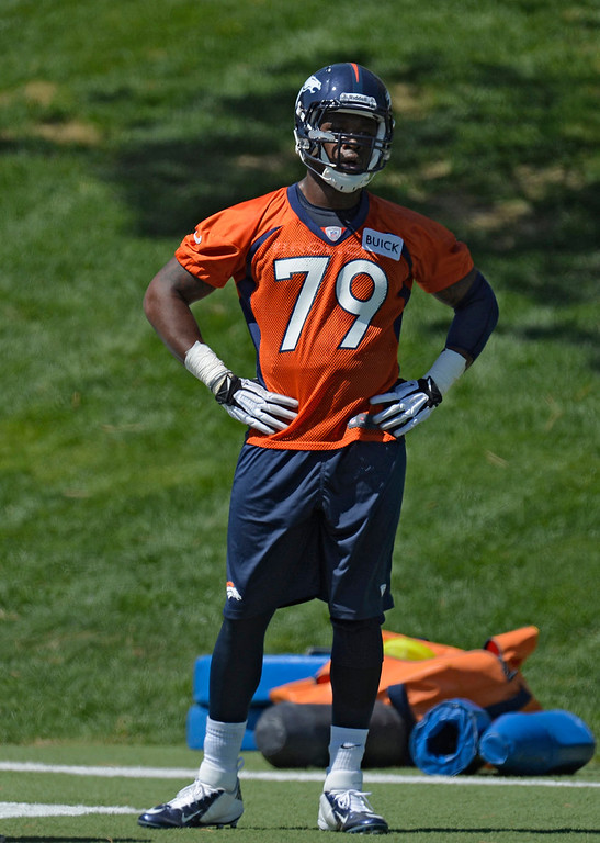 . John Youboty (79) of the Denver Broncos looks on during drils during the last day of rookie mini camp May 12, 20313 at Dover Valley.   (Photo By John Leyba/The Denver Post)