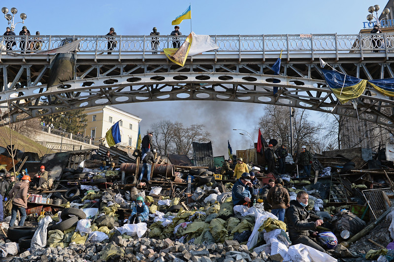 . Anti-government protesters rebuild barricades following continued clashes with police in Independence square, despite a truce agreed between the Ukrainian president and opposition leaders on February 20, 2014 in Kiev, Ukraine. After several weeks of calm, violence has again flared between police and anti-government protesters, who are calling to oust President Viktor Yanukovych over corruption and an abandoned trade agreement with the European Union  (Photo by Jeff J Mitchell/Getty Images)