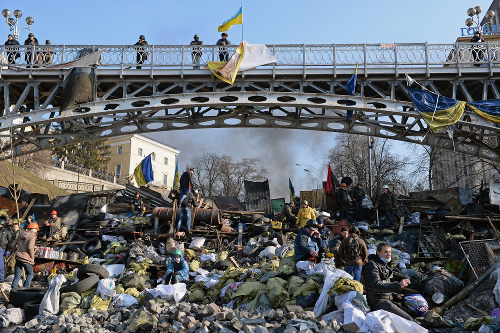 Description of . Anti-government protesters rebuild barricades following continued clashes with police in Independence square, despite a truce agreed between the Ukrainian president and opposition leaders on February 20, 2014 in Kiev, Ukraine. After several weeks of calm, violence has again flared between police and anti-government protesters, who are calling to oust President Viktor Yanukovych over corruption and an abandoned trade agreement with the European Union  (Photo by Jeff J Mitchell/Getty Images)