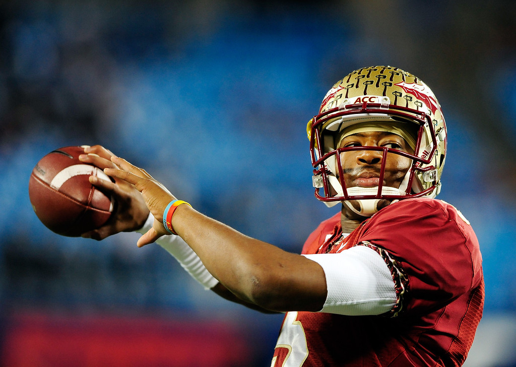 . Quarterback Jameis Winston #5 of the Florida State Seminoles warms up before the ACC Championship game against the Duke Blue Devils at Bank of America Stadium on December 7, 2013 in Charlotte, North Carolina.  (Photo by Grant Halverson/Getty Images)