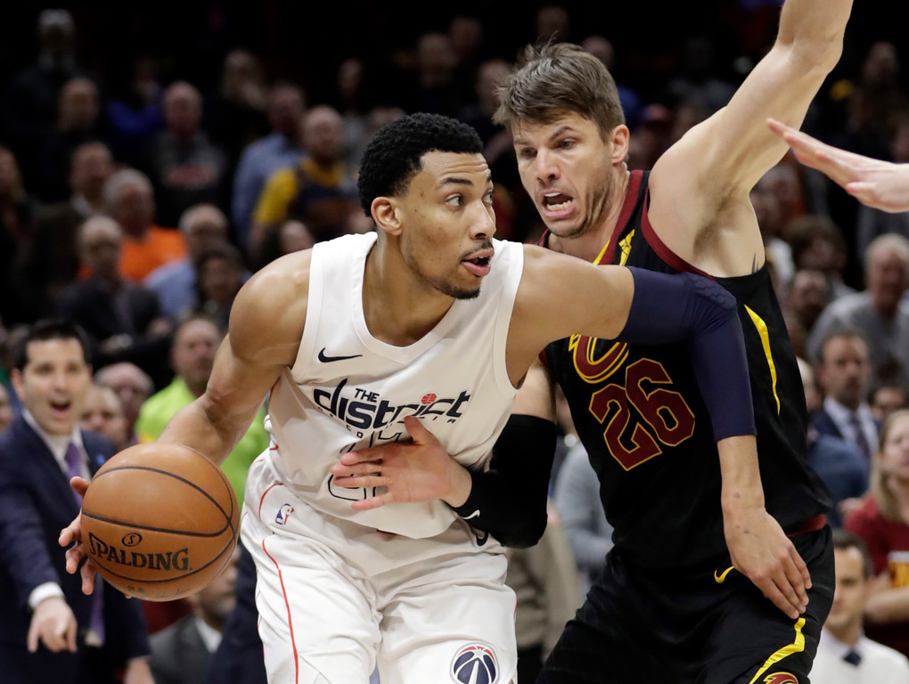 . Washington Wizards\' Otto Porter Jr., left, drives past Cleveland Cavaliers\' Kyle Korver in the second half of an NBA basketball game, Thursday, April 5, 2018, in Cleveland. (AP Photo/Tony Dejak)