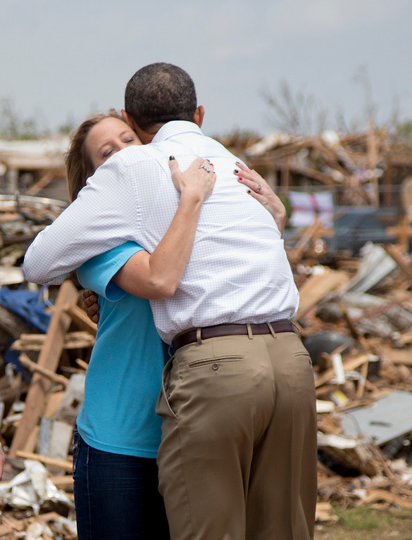 . President Barack Obama embraces Plaza Towers Elementary School principal Amy Simpson as he tours the devastated school Sunday, May 26, 2013, in Moore, Okla., caused by tornado and severe weather last week.  (AP Photo/Carolyn Kaster)