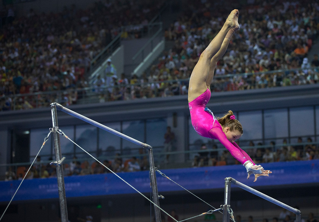 . Madison Kocian of the United States performs on the uneven bars during the women\'s qualifying of the Artistic Gymnastics World Championships at the Guangxi Gymnasium in Nanning, capital of southwest China\'s Guangxi Zhuang Autonomous Region Sunday, Oct. 5, 2014. (AP Photo/Andy Wong)