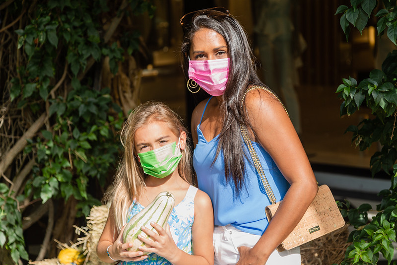 Ara Damhuis and Kerry Malissa of West Palm Beach pose for a photo at the The Royal Poinciana Plaza's Pop-Up Patch for Philanthropy benefitting Cancer Alliance of Help and Hope, Saturday, October 10, 2020. 100 percent of the funds raised from the pumpkin patch will be used to help local cancer patients with their rent/mortgage, utilities, car insurance, car payment and health insurance while undergoing treatment. It's estimated that there will be about 5,000 pumpkins over the duration of the event.(JOSEPH FORZANO / THE PALM BEACH DAILY NEWS)