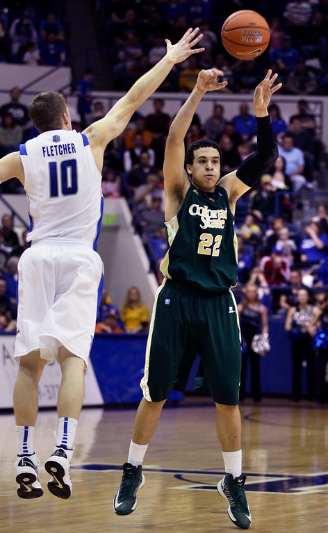 . Colorado State\'s Dorian Green, right, passes as Air Force\'s Todd Fletcher, left, blocks during the second half of an NCAA college basketball game in Air Force Academy, Colo., Saturday, Feb. 16, 2013. Colorado State won 89-86. (AP Photo/Brennan Linsley)
