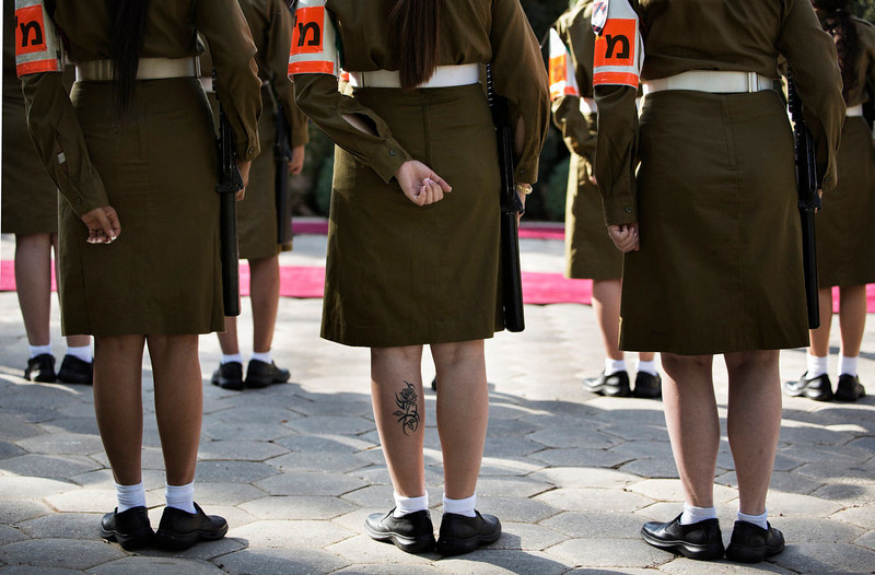 . A rose tattoo is seen on the calf of a female Israeli soldier lined up with her comrades during a rehearsal, ahead of a state visit of Bulgarian President Rosen Plevneliev, who is to meet with his Israeli counterpart Shimon Peres on October 22, 2012. MARCO LONGARI/AFP/Getty Images