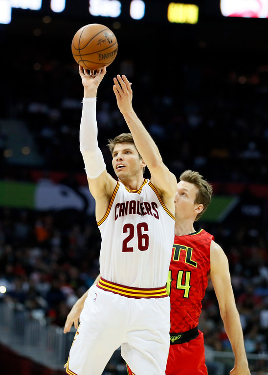 . Cleveland Cavaliers guard Kyle Korver (26) takes the shot in the second half of an NBA basketball game agains the Atlanta Hawks on Sunday, April 9, 2017, in Atlanta. The Hawks won in overtime 126-125. (AP Photo/Todd Kirkland)