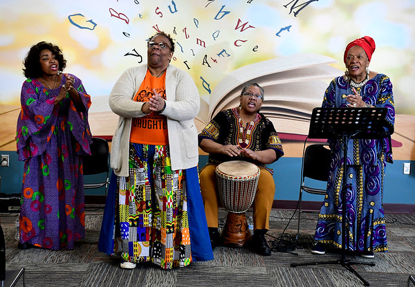 2/29/2020 Mike Orazzi | Staff Nzinga's Daughter's Taffie Bentley, Dayna Snell, Alison Johnson and Gail Williams during a performance centered on the Underground Railroad at the New Britain Public Library on Saturday morning.
