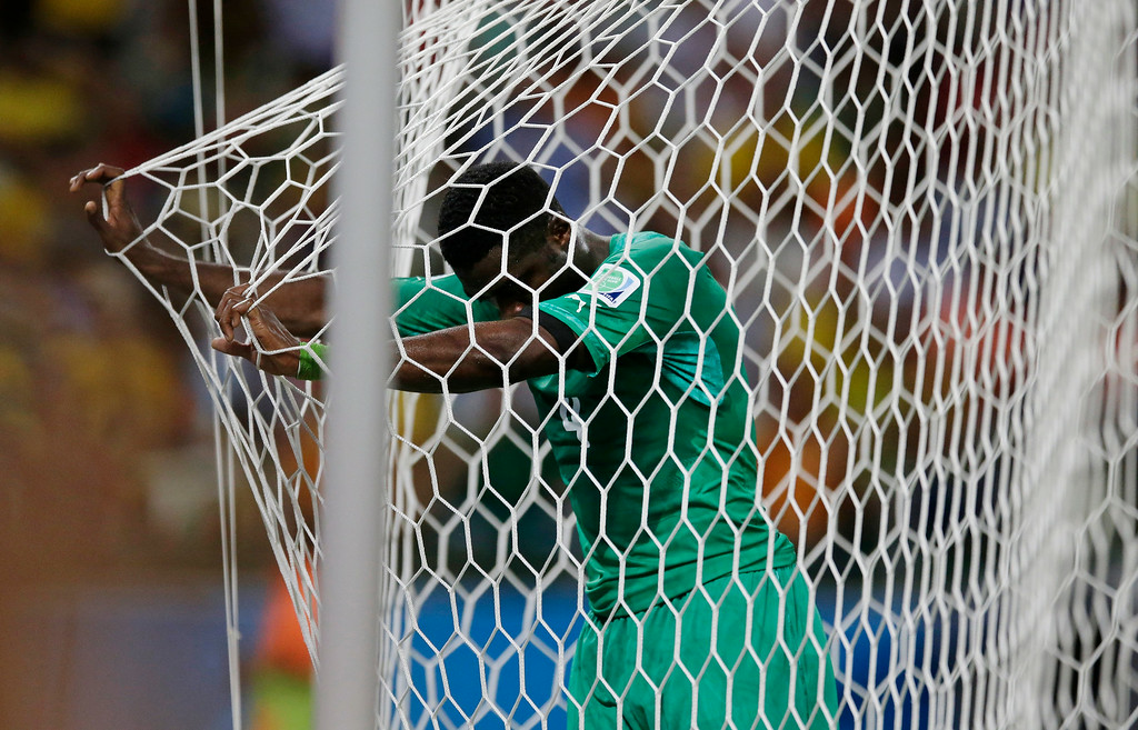 . Ivory Coast\'s goalkeeper Boubacar Barry stands at the back of his goal after being scored on by Greece\'s Andreas Samaris during the group C World Cup soccer match between Greece and Ivory Coast at the Arena Castelao in Fortaleza, Brazil, Tuesday, June 24, 2014. (AP Photo/Bernat Armangue)